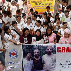 Various groups gather at Plaza Miranda in Quiapo, Manila yesterday to demand the immediate release of three Red Cross workers.