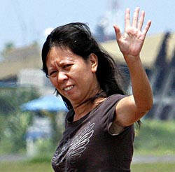 Freed hostage Mary Jean Lacaba waves as she prepares to board a Manila-bound private plane at Andrews Air Base in Zamboanga City yesterday.